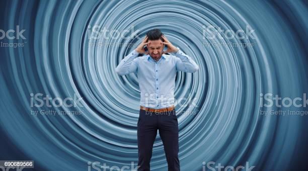 Businessman against vortex background.
