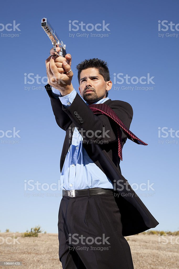 Businessman aiming a handgun royalty-free stock photo