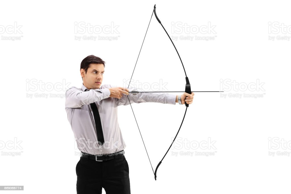 Businessman aiming with a bow and arrow stock photo