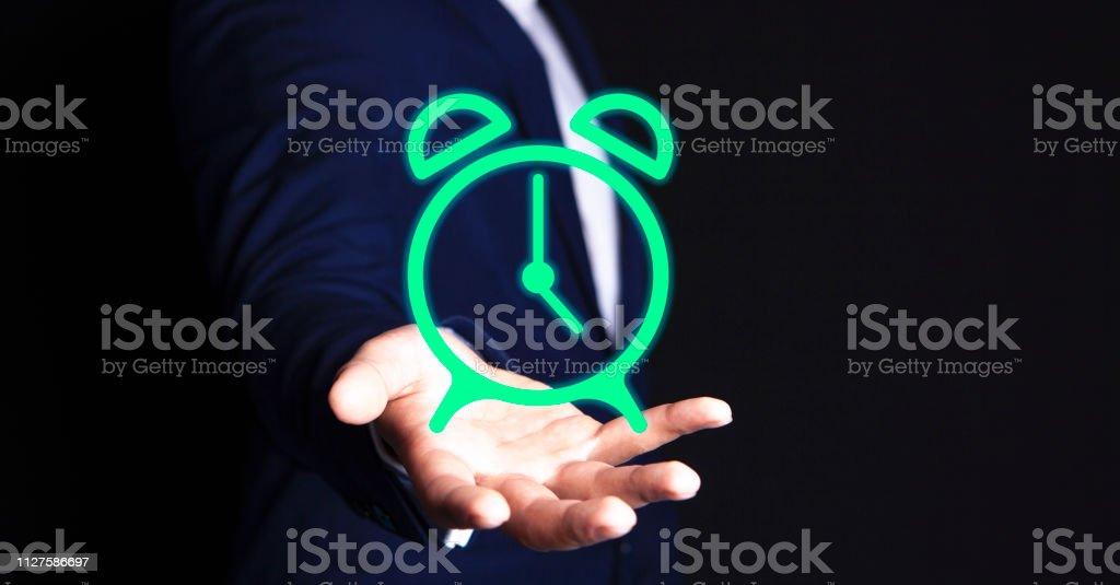 businessman alarm clock stock photo