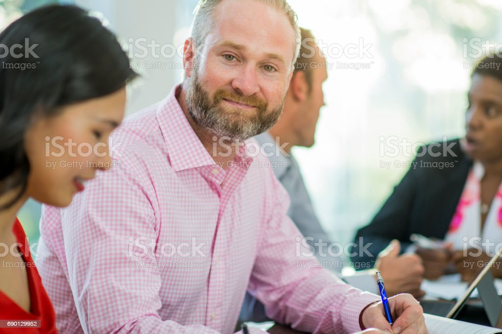 Businessman Among Colleagues stock photo