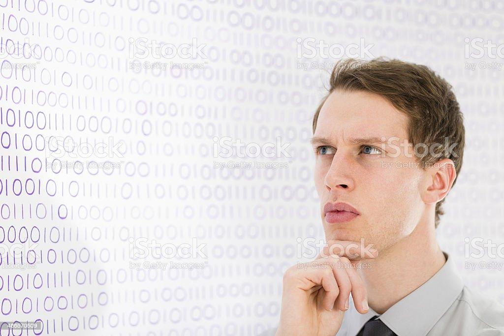 Businessman analysing binary code data royalty-free stock photo