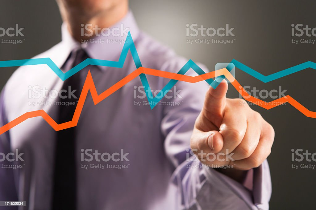 Businessman analysing graph data on touch screen royalty-free stock photo