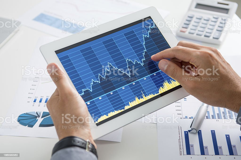 Businessman Analysing Growth With Tablet stock photo