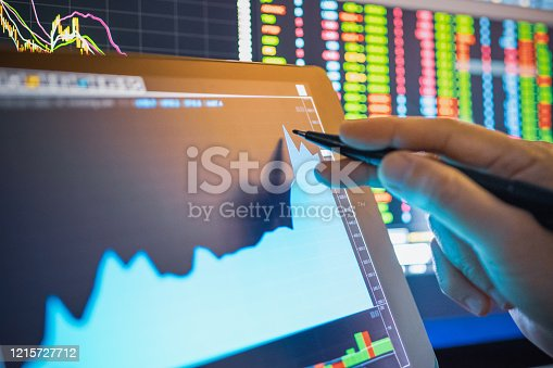 istock Businessman analysis stock chart in crisis covid-19 for investment in stockmarket and finance business planning selective stock for Stockmarket crash and Financial crisis 1215727712