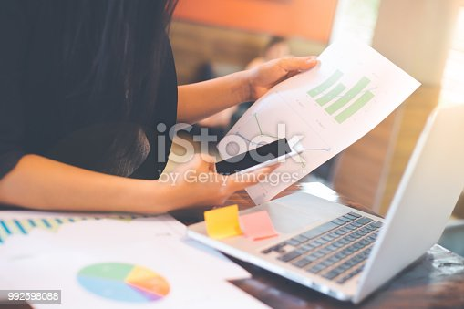 996183898 istock photo Businessman analysis working discussing the charts and graphs showing the results. 992598088