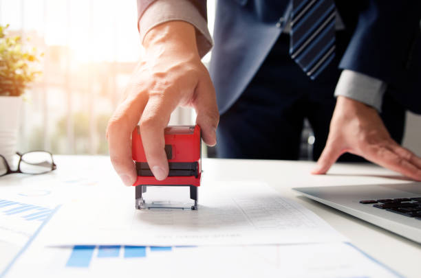 Businessman analyst working with graph, chart and stamp Businessman analyst working with graph, chart and stamp. business strategy finance statement report graph approve concept rubber stamp stock pictures, royalty-free photos & images