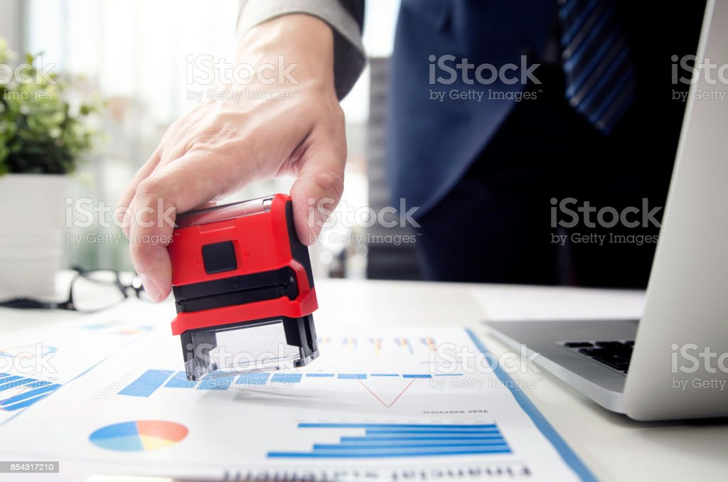 Businessman analyst working with graph, chart and stamp stock photo