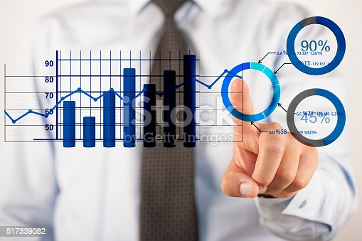 istock Businessman analyzing business diagrams 517339082