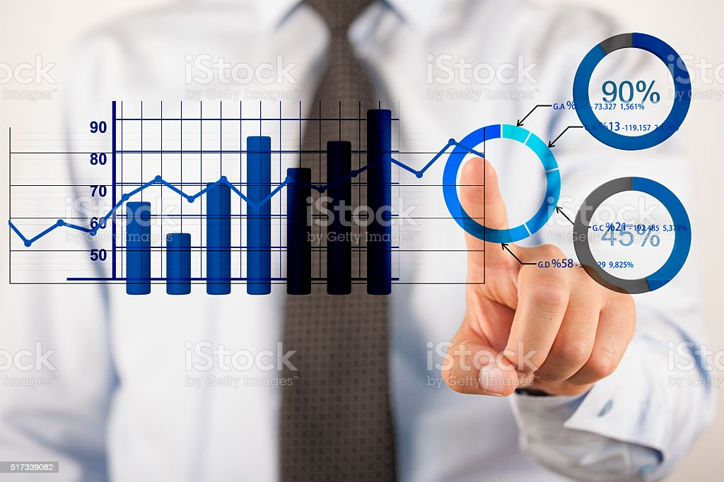 Businessman analyzing business diagrams stock photo