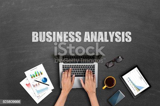 527033580 istock photo Businessman analyzing business reports on laptop 525809666