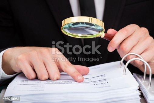 istock Businessman Analyzing Document 466049981