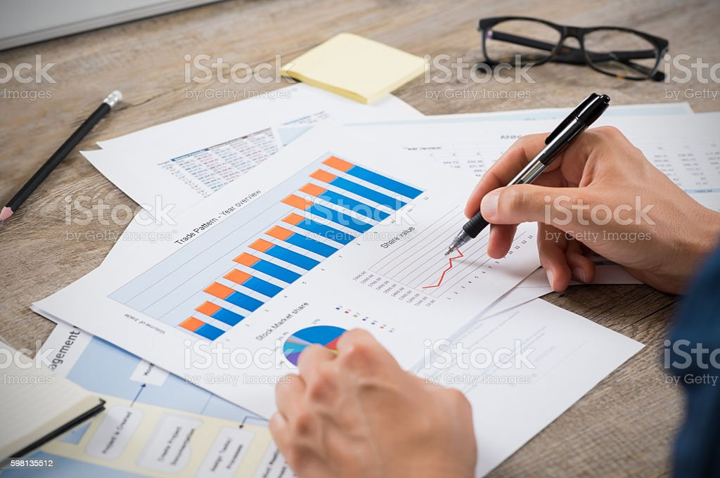 Businessman analyzing graphs stock photo
