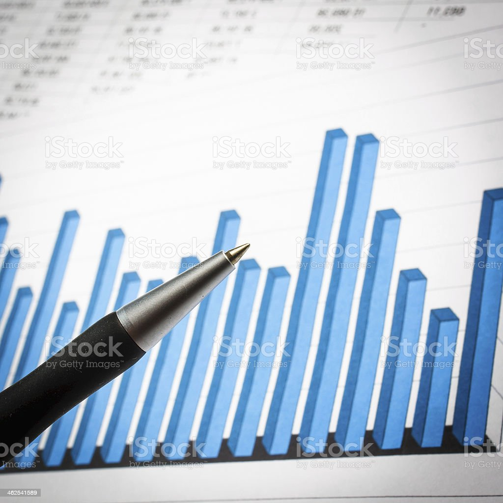 Businessman analyzing investment charts at his workplace stock photo