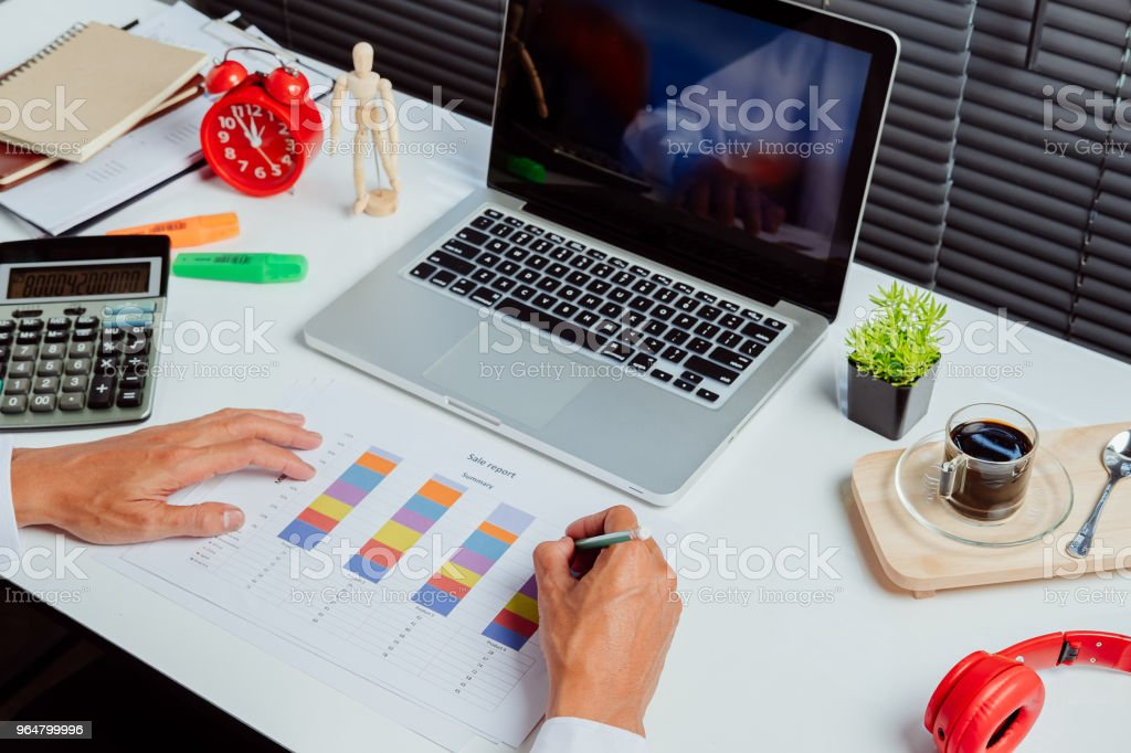 Businessman analyzing investment charts royalty-free stock photo