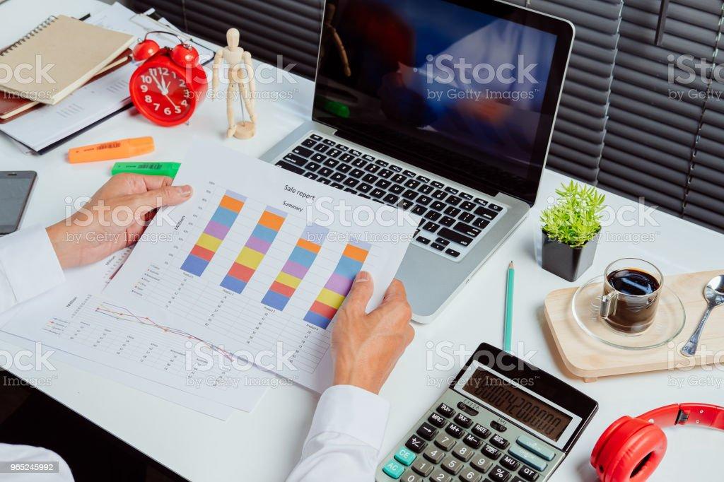 Businessman analyzing investment charts zbiór zdjęć royalty-free