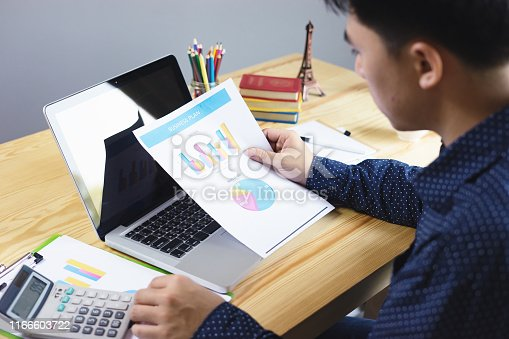 istock Businessman analyzing investment charts with calculator laptop. Accounting and technology in office.Business people using laptop at office,Analyze plans.selective focus,vintage color,home office 1166603722