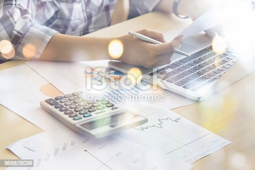 istock Businessman analyzing investment charts with calculator laptop. Accounting and technology in office.Business people using laptop at office,Analyze plans.selective focus,vintage color 968826036