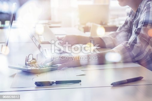 istock Businessman analyzing investment charts with calculator laptop. Accounting and technology in office.Business people using laptop at office,Analyze plans.selective focus,vintage color 968826512