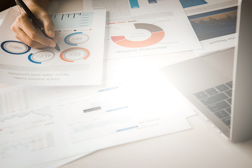 1044507110 istock photo Businessman analyzing investment charts with laptop. Accounting and Business concept 1252997103