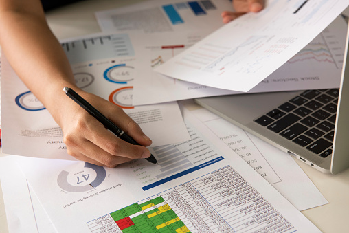 1044507110 istock photo Businessman analyzing investment charts with laptop. Accounting and Business concept 1252997113