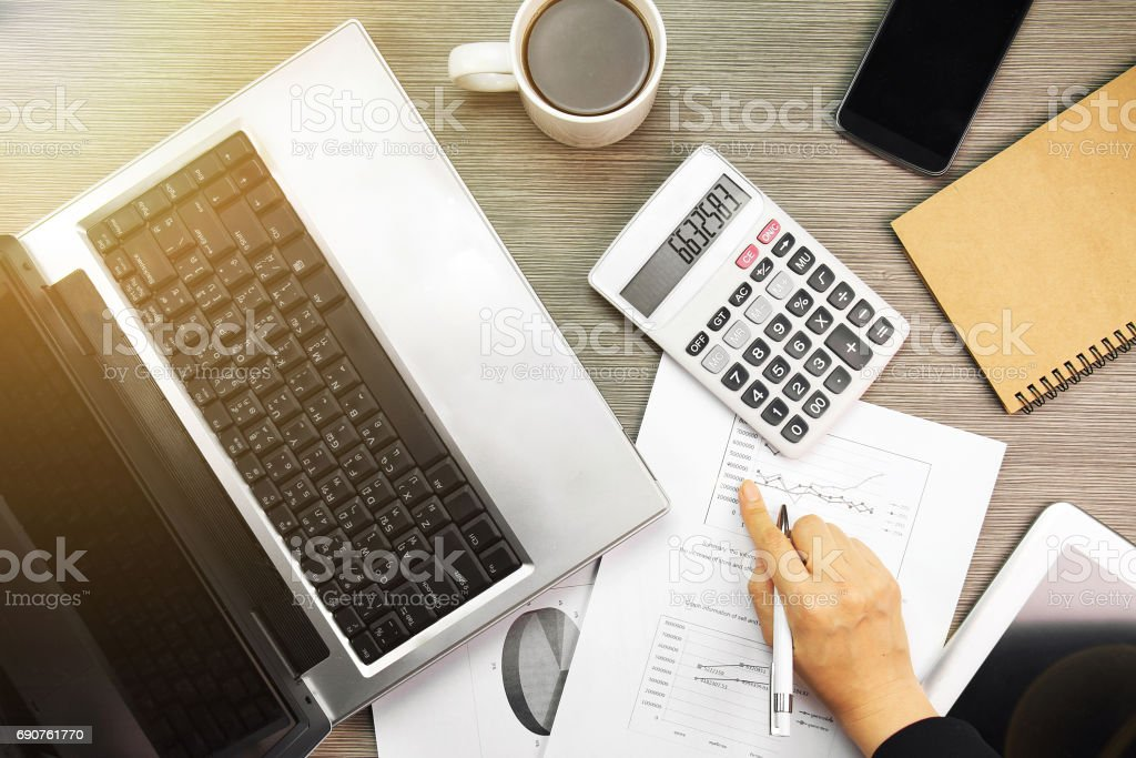 Businessman analyzing investment charts with laptop. Accounting. stock photo