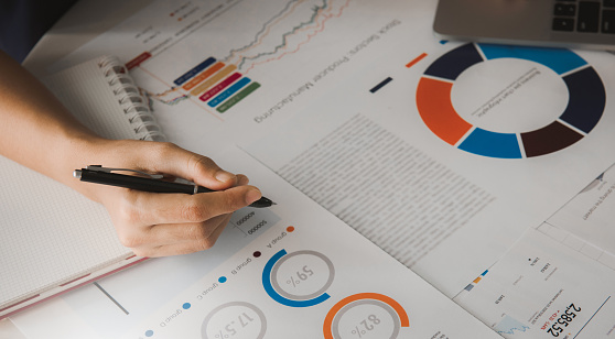 1044507110 istock photo Businessman analyzing investment charts with laptop. Business concept. 1252997118