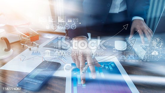 istock Businessman analyzing sales data and economic growth and pointing at business report document with icon and graph financial, marketing, online banking and payment, business planning and strategy. 1182774062