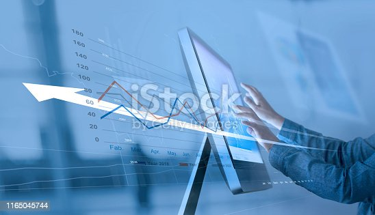 istock Businessman analyzing sales data on computer networking, Abstract interface, and economic growth graph chart with social network diagram, digital marketing. 1165045744