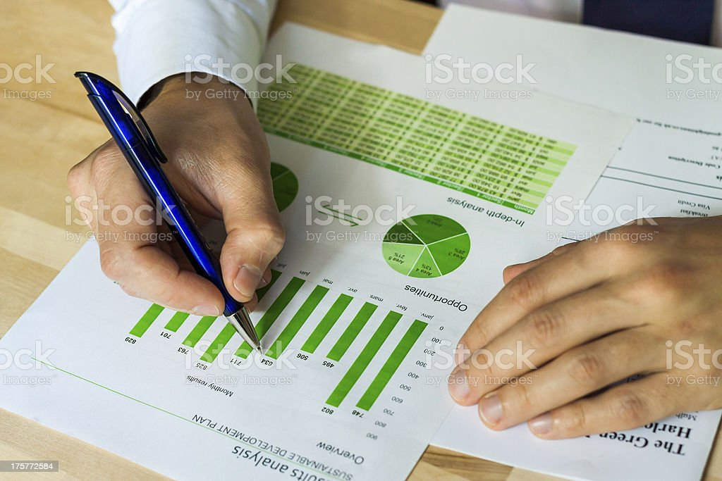 Businessman analyzing sustainable development chart royalty-free stock photo
