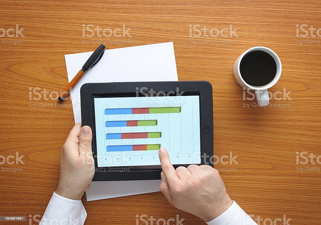 Businessman analyzing with tablet pc royalty-free stock photo