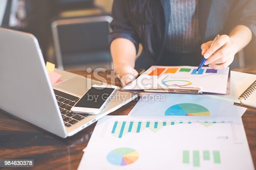 996183898 istock photo Businessman analyzing working discussing the charts and graphs showing the results. 984630378
