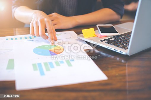996183898 istock photo Businessman analyzing working discussing the charts and graphs showing the results. 984630380