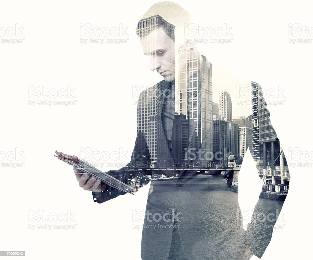businessman and a city using a tablet stock photo
