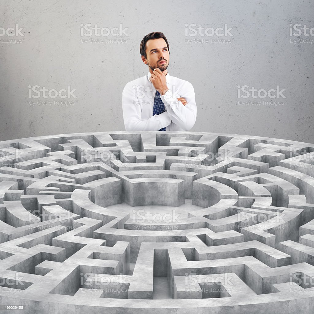 Businessman and a maze stock photo