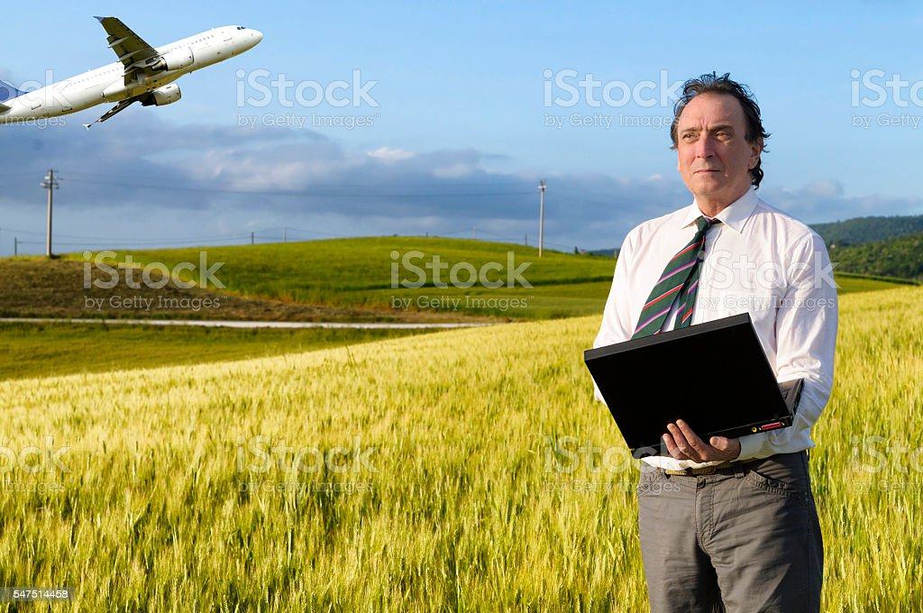 Businessman and airplane stock photo