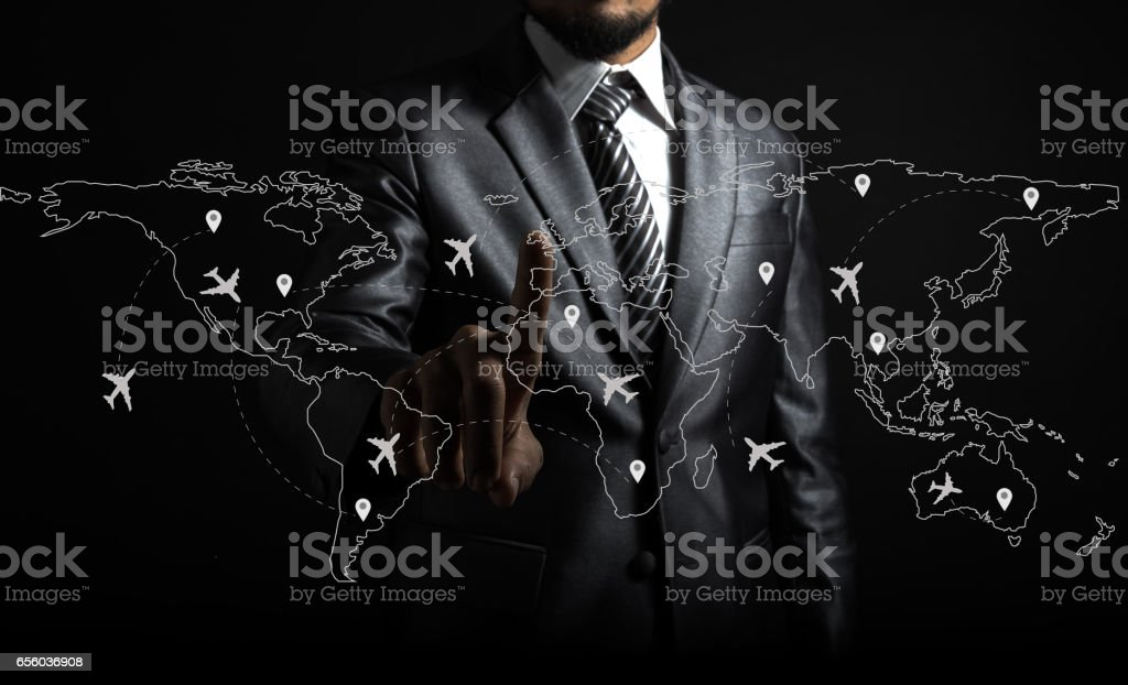 Businessman and airplane routes on world map stock photo