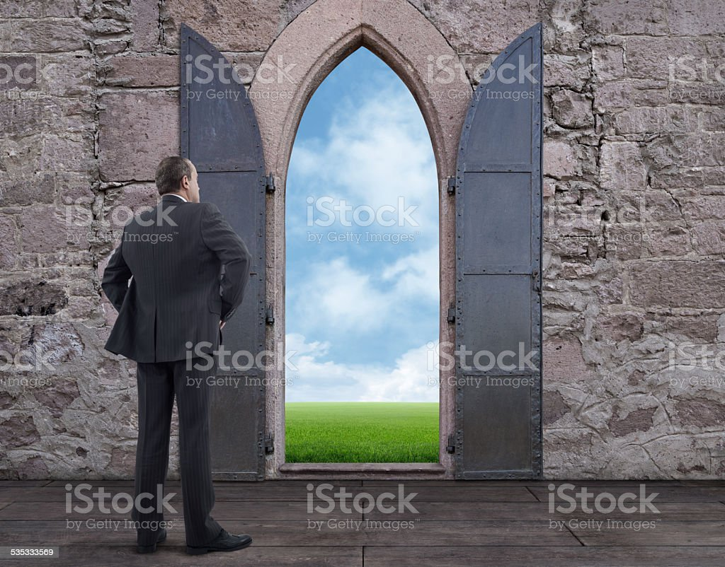 Businessman and Ancient Door royalty-free stock photo