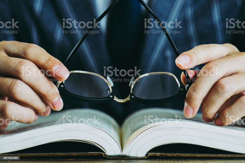 Businessman and book stock photo