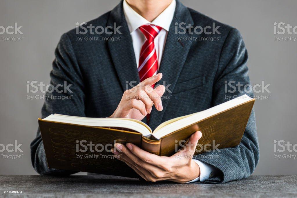 Businessman and book,studio shooting stock photo