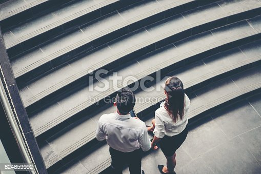 684803840istockphoto Businessman and Business woman go up the stairs Success concept 824859992