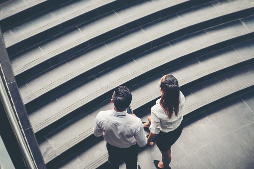 684803840 istock photo Businessman and Business woman go up the stairs Success concept 824859992