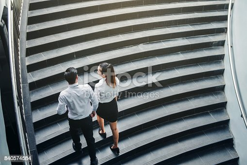 684803840istockphoto Businessman and Business woman go up the stairs Success concept 840574584