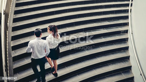 684803840istockphoto Businessman and Business woman go up the stairs Success concept 876460242