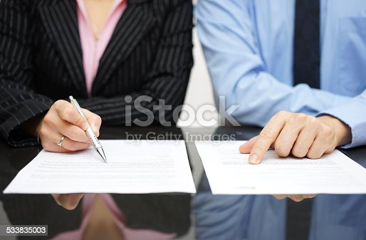 istock businessman and businesswoman are inspecting  contract 533835003