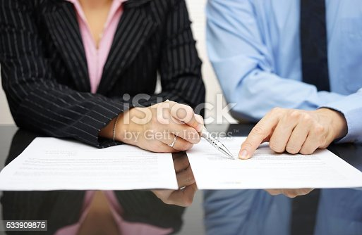 istock businessman and businesswoman are pointing to .article of the treaty 533909875