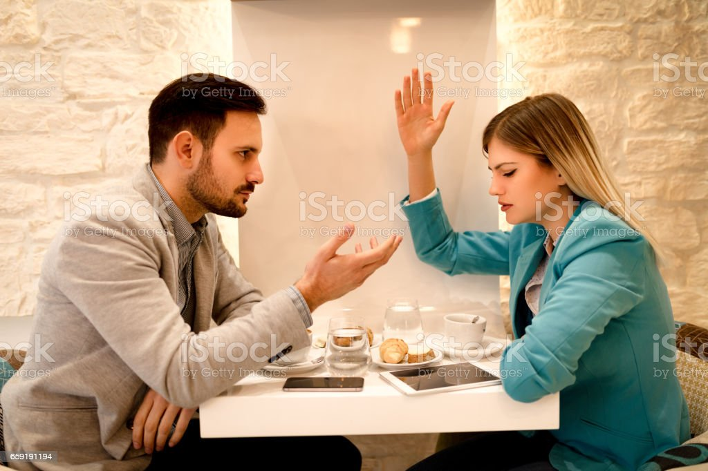Businessman And Businesswoman Arguing In A Cafe stock photo