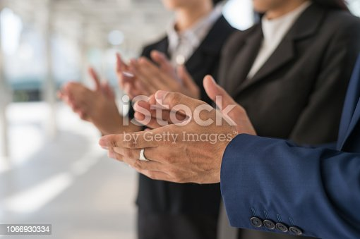 924520168 istock photo businessman and businesswoman clap their hands to congratulate the signing of contract between their companies. success, greeting and partner concept. 1066930334