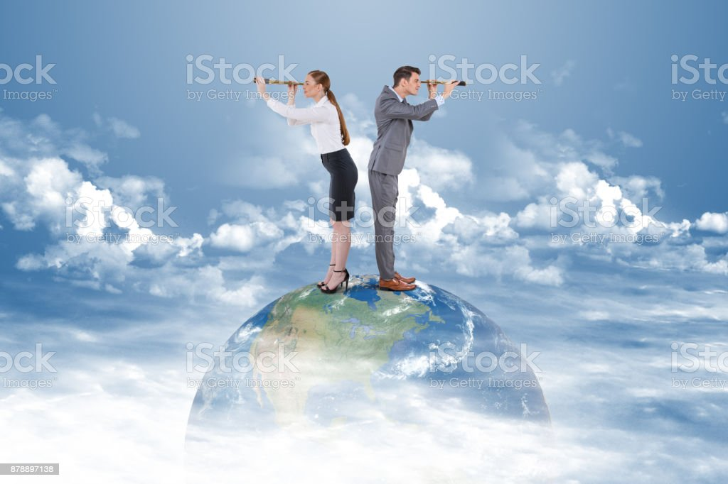 Businessman and businesswoman exploring the future using telescope stock photo
