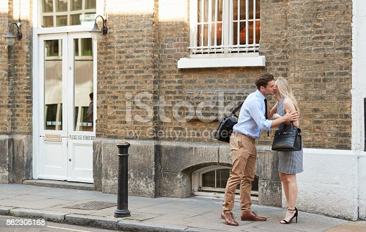 Businessman And Businesswoman Greeting Each Other On Street